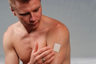 Man Wearing Nicotine Patch --- Image by © Larry Mulvehill/Corbis
