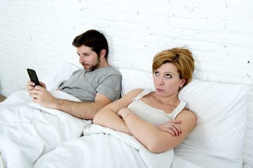 woman ignored by husband in bed