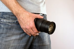 man with camera lens on crotch