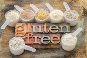 gluten free flour in measuring cups, celiac