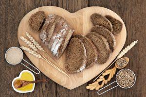 gluten free bread on heart shaped wood board