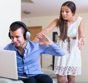 man ignoring wife while watching porn