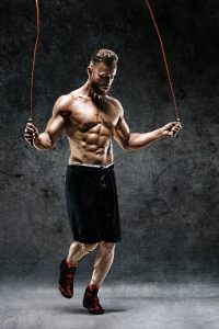 fit muscular man jumping rope for cardio