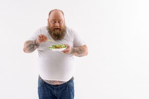 fat man eating salad and started with Progentra