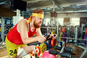 overweight man working out in gym and started taking Progentra for healthy lifestyle