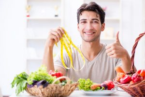 man adding vegetables and fruits to his diet to lose weight