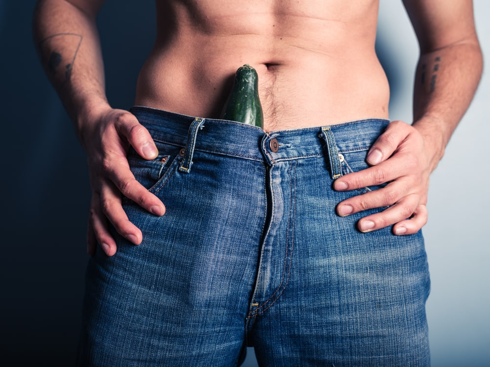 cucumber inside man's jeans depicting his penis