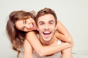 smiling couple happy about benefits of Progentra