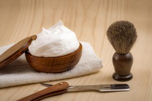 shaving cream brush and razor or manscaping