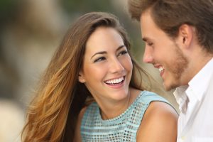 couple on smiling at each other