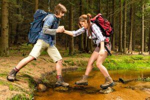 young couple nature trek