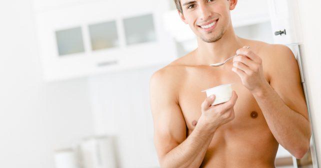 fit guy eating yogurt