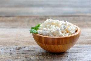 cottage cheese in wooden bowl