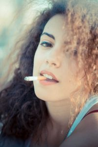 curly haired girl smoking