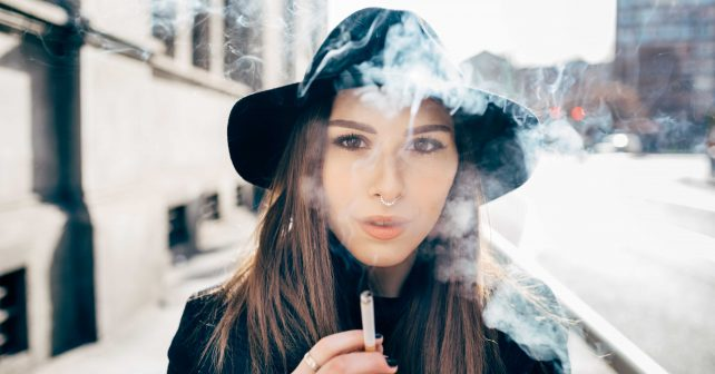 fashionista smoking in the streets